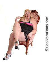 Big girl. - An big overweight woman sitting in an pink...