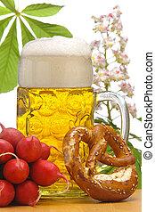 big glass of german bavarian beer at world famous beer festival Oktoberfest in Munich