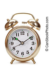 Big gold alarm clock on a white background
