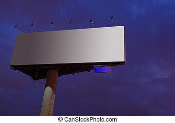 Big gray billboard at night, bright illumination, dark blue sky