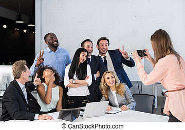 Big Group Of Business People In Office Together, Businesswoman Taking Photo Of Colleagues On Cell Smart Phone, Team Meeting Mix Race Coworkers Businesspeople
