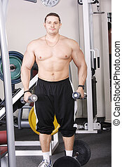 Big guy with dumbbells