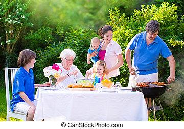 Big happy family enjoying bbq grill in the garden - Grill...