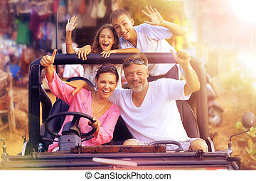 Big happy family in car