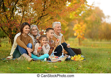 big happy family on picnic