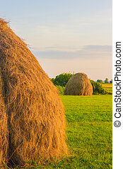 Big haystack at field inthe country