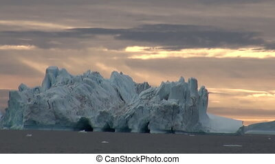 Big icebergs floating in sea around Greenland. - Big...