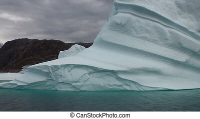 Big icebergs floating in sea around  Greenland.