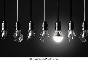 Big idea - Idea concept with broken bulbs and one glowing...