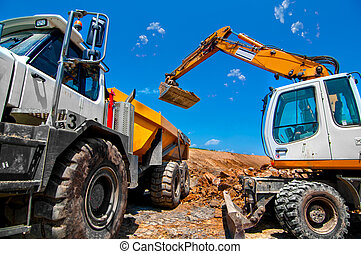 Big, industrial excavator on new construction site loading