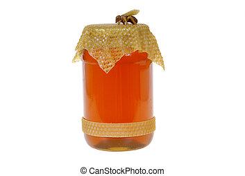 honey - big jar of the honey isolated on white background