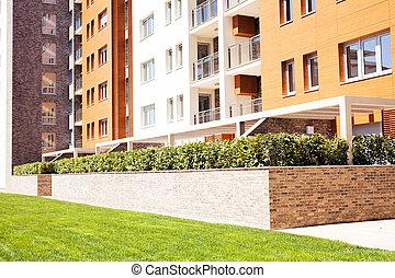 jardiniera of the bricks with ornamental bush