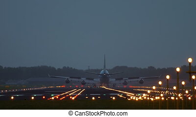 Big Jet airplane landing - Widebody four-engine jet airplane...