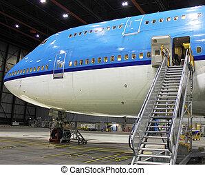 big jet in hangar