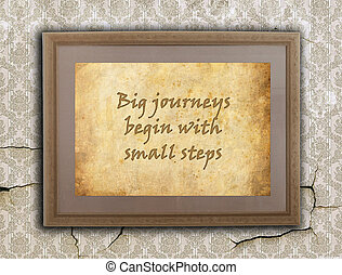 Big journeys, small steps - Old wooden frame with written...