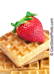 big juicy ripe strawberries and waffles isolated on white