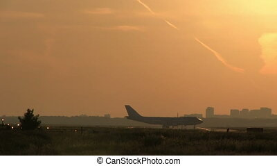 Big jumbojet taxiing on runway