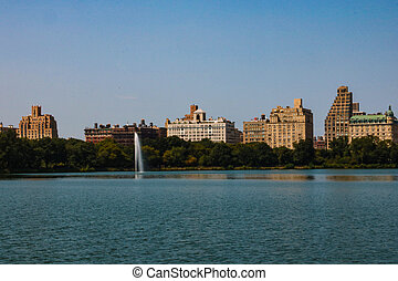 big lake in central park with blue cloudy sky, manhattan new york, usa.