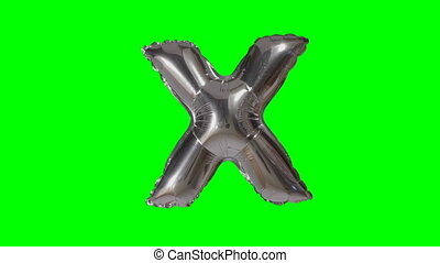 Big Letter X from alphabet helium silver balloon floating on...