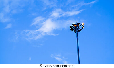light pole of floodlight on evening dusk sky background