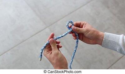 Big lock knot - Sailor Tie big lock knot on blue rope on...