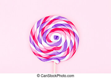 Big lollipop on solid pink background. Horizontal