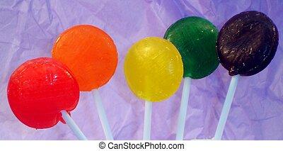 Big Lollipops - Rainbow of lollipops on a purple background...