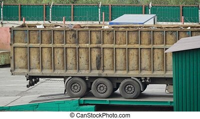 big lorry loaded with waste is going in reverse from...
