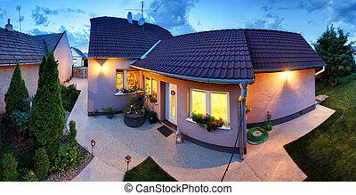 Big luxury house at dusk, night, panorama