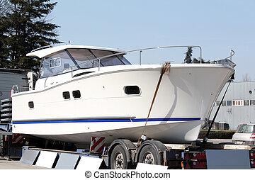 big luxury yacht on trailer