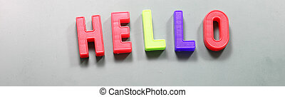 big magnetized letters with text HELLO on the blackboard