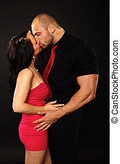 Big man kissing girlfriend
