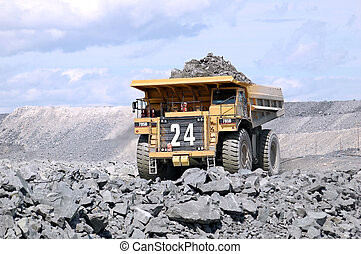 A picture of a big mining truck taken at a gold mine (open pit)
