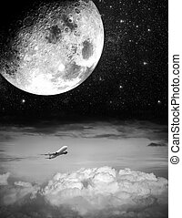 Big moon and airplane above the clouds