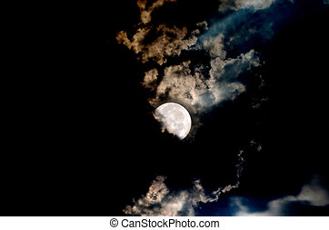 Big Moon Over The Clouds In A Dark