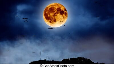 Big moon shines brightly on the sky and bats fly. Smoky background