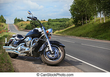 Big motorcycle on the side of a country road