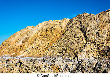 Big mountains of sand mixed with salt. - Large mountains of...