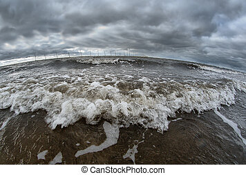 ocean wave breaking the shore