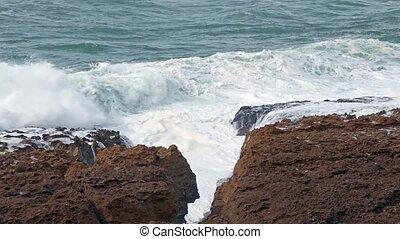 Big Ocean Waves Breaking on Rocks