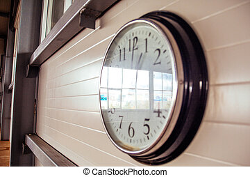 Big office clock on white wall