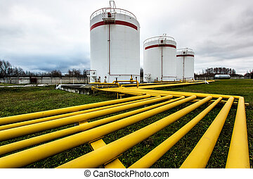 Big oil tanks in a refinery - Big industrial oil tanks in a...