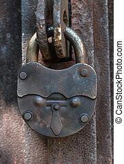 old lock - big old lock keeps this door shut