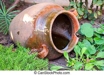 Big old retro jug, decoration in the garden