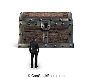 Big old treasure chest with small businessman looking at