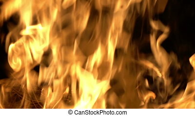 Big orange fireplace fire burning in slow motion