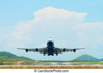 Big passenger airplane flying and taking off from an airport