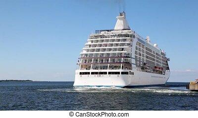 big passenger liner departures from mooring in sea