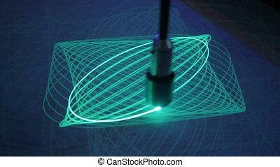 Big pendulum draws ellipses with light on phosphorus...