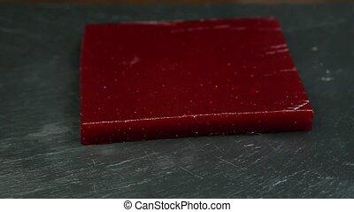 big piece of handmade crimson marmalade served on black...
